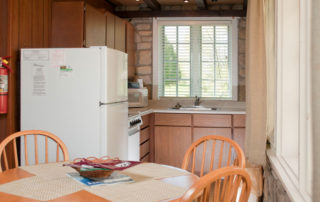 Studio full kitchen with a refrigerator, oven, stove, and microwave