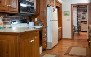 Hermitage full kitchen with a refrigerator, dishwasher, range, and microwave