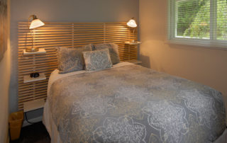 Falun House bedrooms with a queen bed