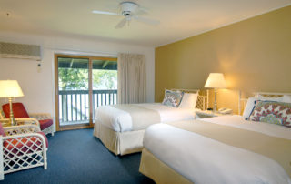 Interior of a Shoreside Motel room with two beds and chairs
