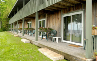 Shoreside Motel's wooden decks with chairs and sliding doors
