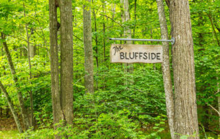 Sign for Bluffside surrounded by woods